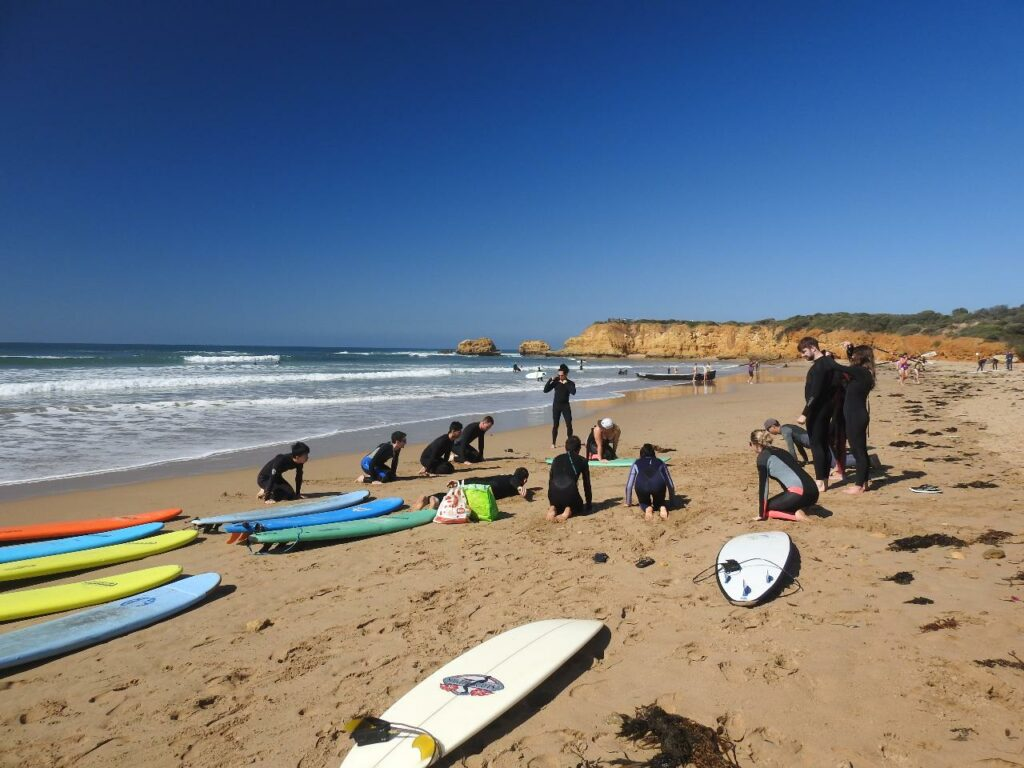 Group surf lesson on the beach in Torquay
